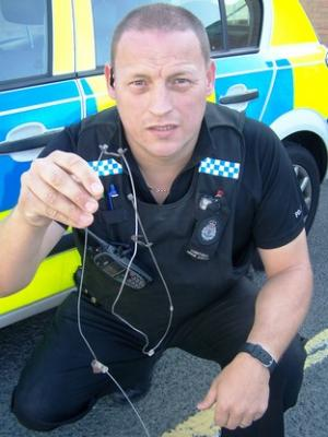 PC Simon Albutt with the illegal snares