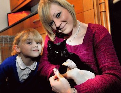 lucky escape: Amelia and Katie Shine are pleased to have their cat Darcy home